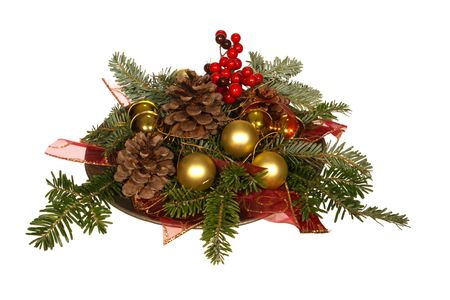 old fashioned christmas: Old fashioned Christmas decoration with pine branch, pine cones and berries on a tin plate, isolated on white Stock Photo