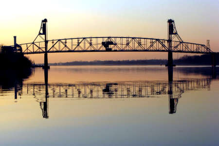 draw bridge: Vertical lift bridge at dusk over an American river Stock Photo
