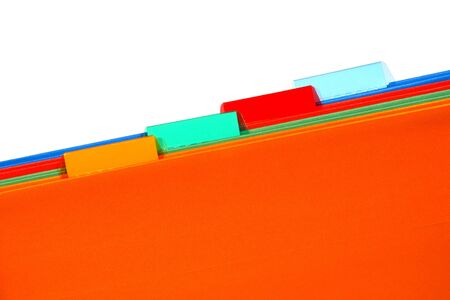 Assorted colors orange, green, red, and blue file folders with plastic tabs over white background Archivio Fotografico