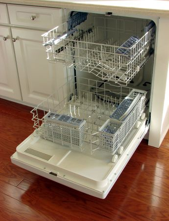 Modern dishwasher with racks pulled out Stock Photo - 2404510