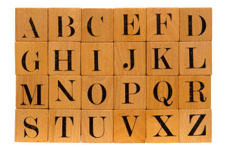 old letters: Antique partial wood block alphabet toy isolated on white