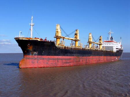 Bulk carrier cargo ship sailing on calm waters Stock Photo