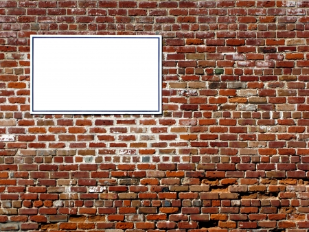Old brick wall with blank sign ready for copy