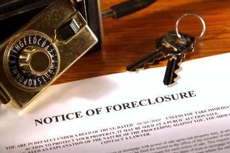 Foreclosure notice with keys and real estate lock box photo