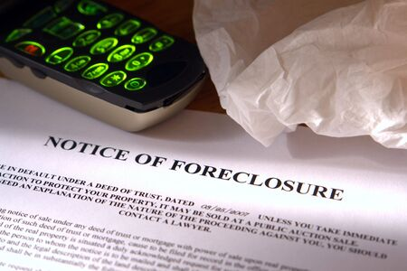 eviction: Foreclosure notice with tissue and cell phone Stock Photo