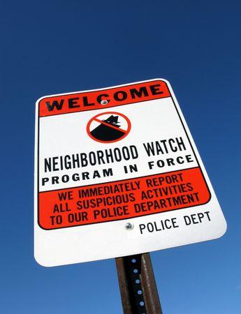 residential neighborhood: American residential neighborhood crime watch warning sign over blue sky Stock Photo