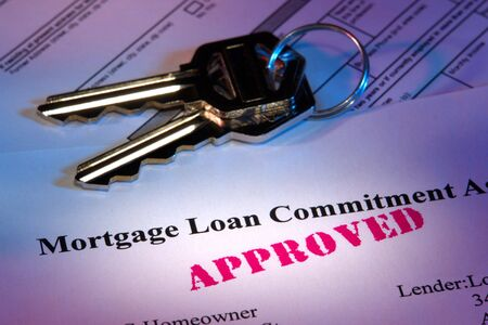 homeownership: Residential mortgage loan commitment letter with approved stamp imprint and house keys