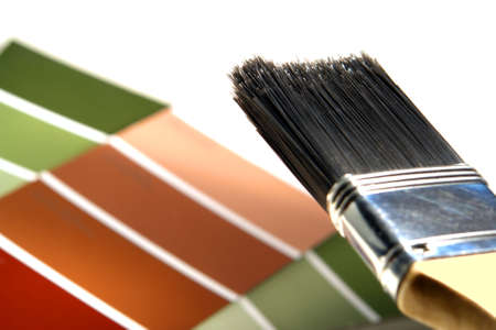 bristle: Bristle paint brush over paint color chips on white background
