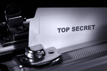 Top secret document in a folder inside an armored suitcase