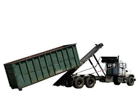 Truck loading or unloading a roll-off trash dumpster container photo