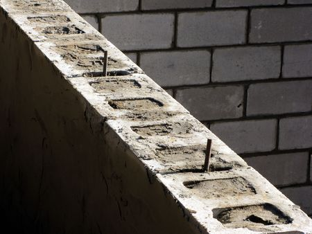 Cinder blocks house foundation wall under construction