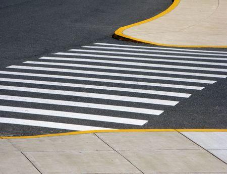 Pedestrian crosswalk with handicap accessible curbs on sidewalk