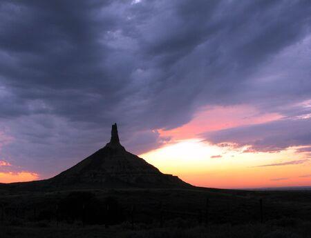 nebraska: Chimney Rock National Monument at dusk in Nebraska Stock Photo