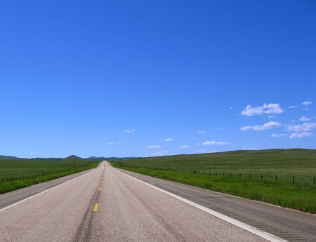 Straight stretch of country road in open country in the American West