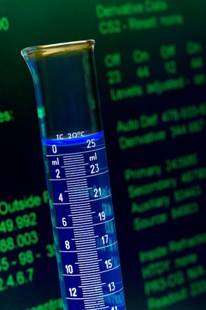 Scientific cylinder and experiment data screen in a research lab Stock Photo