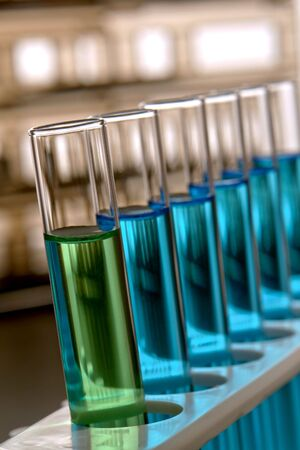 Group of glass test tubes in a science research lab photo