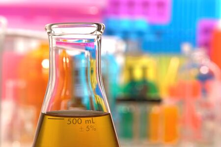 erlenmeyer: Glass Erlenmeyer flask fille with fuel like liquid in a science research lab
