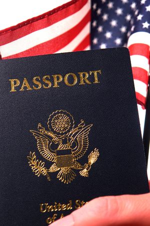 Hand holding a United States of America new electronic passport book and a US flag Stock Photo - 3794994