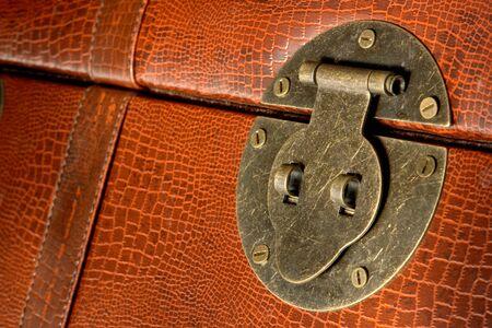 Old fashioned brass latch lock on a crocodile leather style steamer trunk luggage Zdjęcie Seryjne