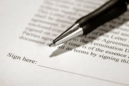 endorsement: Sign here line on a contract with ball point pen