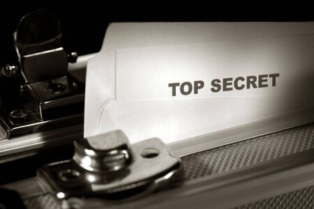 Top secret document emerging from a file folder inside an armored briefcase photo