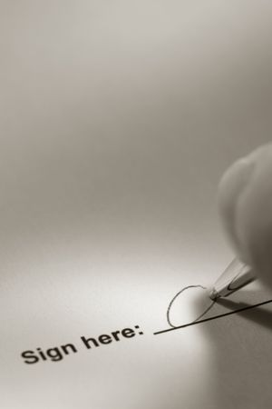 Fingers holding a pen and signing a document on the signature line Stock Photo - 3883140