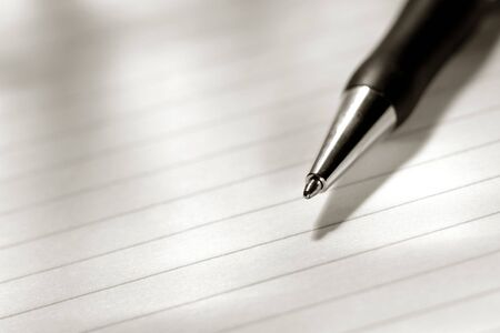 Ballpoint pen on a blank sheet of ruled paper Stock Photo - 3883142