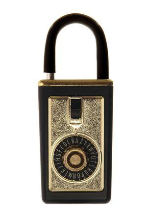 lockbox: Traditional real estate combination lock box isolated on white Stock Photo