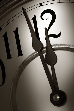 Clock hands showing time two minutes before the midnight hour Imagens
