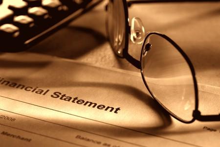 brokerage: Financial bank or brokerage statement with glasses