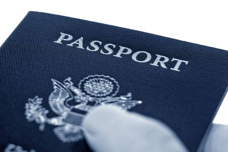 Hand handing out a United States of America new electronic passport book Stock Photo - 4082511