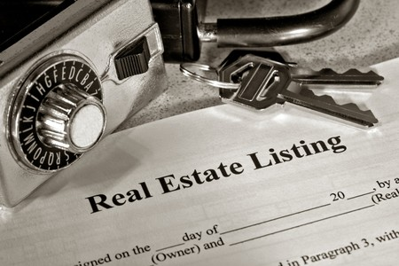 Real estate listing contract with keys and lock box Stock Photo