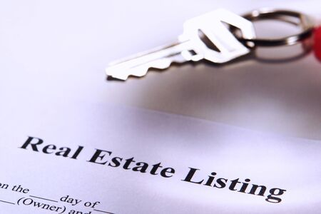 estate: Real estate listing contract and key on a key chain