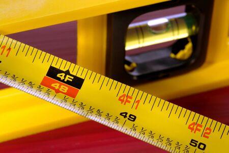 retractable: Construction retractable tape measure with bubble spirit level Stock Photo