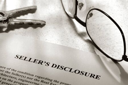 Real estate home owner seller disclosure statement with glasses and keys