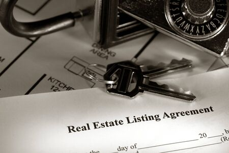 Real estate listing contract with house keys and combination lock box photo