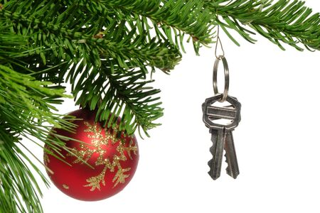 christmas house: House key hanging as ornament on a Christmas tree