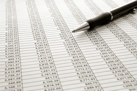 Spreadsheet with financial figures numbers with ball point pen Banco de Imagens