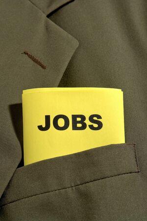 job posting: Job posting list folded in an executive business man suit jacket pocket