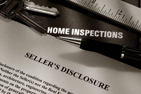 Home Inspection: Real estate home owner seller disclosure statement with home inspection folder report cover pen keys and ruler Stock Photo