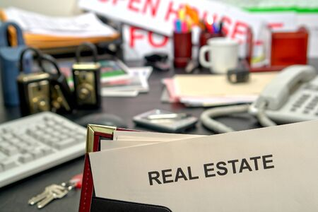 Real estate blank document on busy Realtor desk in realty agent office Stock Photo - 4223324