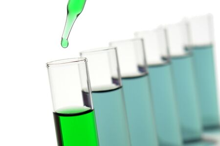 Pipette with drop of liquid over test tubes for an experiment in a science research lab Stock Photo - 4440343
