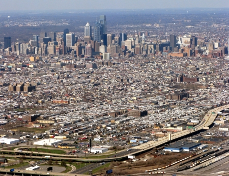 Aerial view of Philadelphia Pennsylvania showing Downtown Center City, South Philly, and interstate I-95 in foreground (all visible signs and billboards have been blanked out) Stock Photo