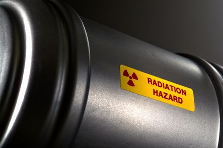 Nuclear radioactive material metal container with radiation hazard warning label Фото со стока