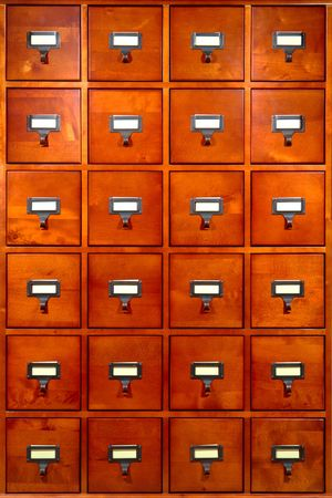 Old fashioned library card storage wood cabinet with 24 drawers and pulls Stock Photo - 5421602