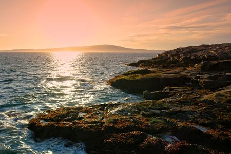 The coast of Maine and Mount Cadillac in Acadia National Park at Sunset Stock Photo
