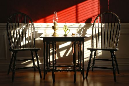 Colonial style historic home interior decor with Windsor chairs and gateleg table photo
