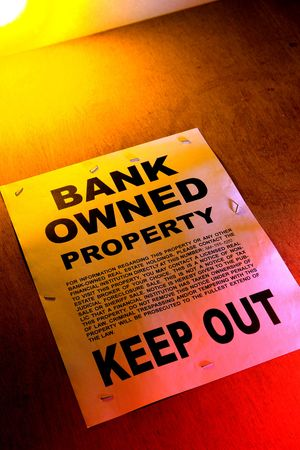 owned: Grunge Real estate lender bank owned keep out  sign notice posted on a boarded up foreclosed building in foreclosure (fictitious document)