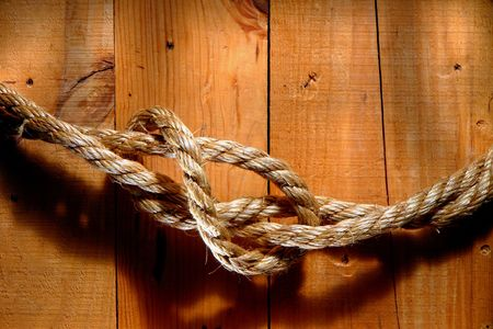 barnwood: American West old rodeo rope with loop on barn wood