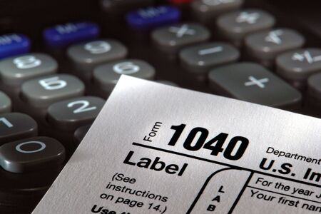 Amerikaanse IRS Internal Revenue Service belasting formulier 1040 en reken machine